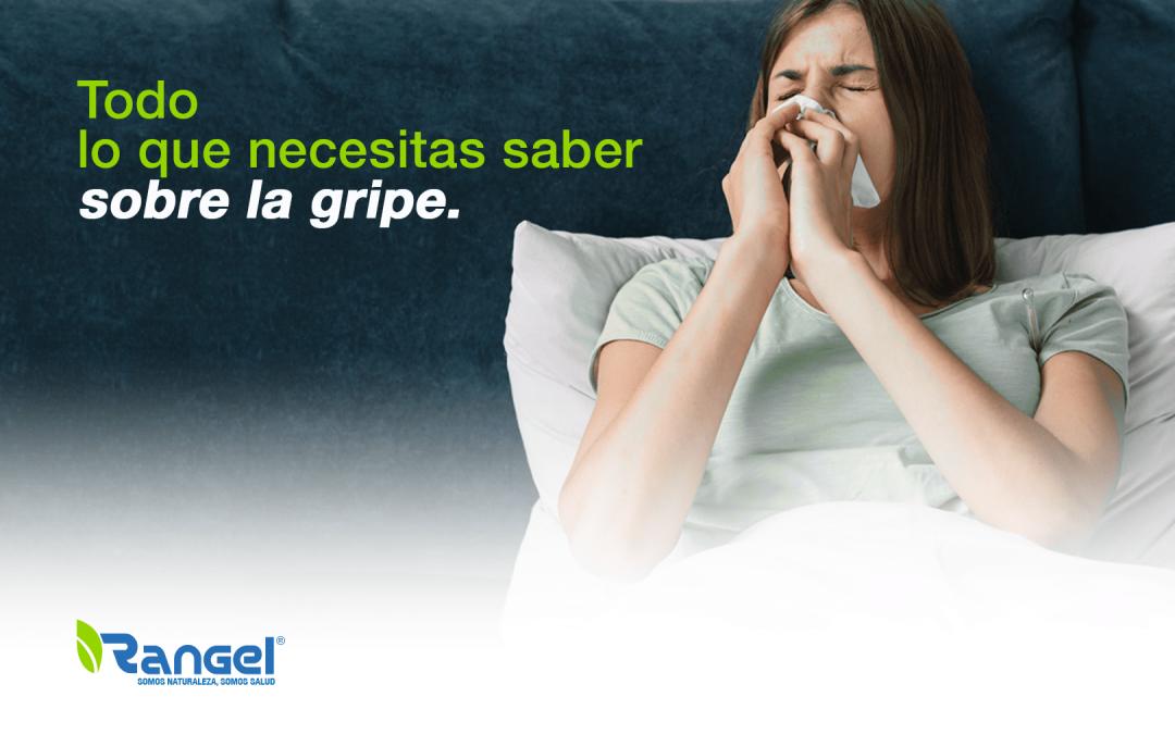 Mujer en cama estornudando, todo lo que necesitas saber de la gripe